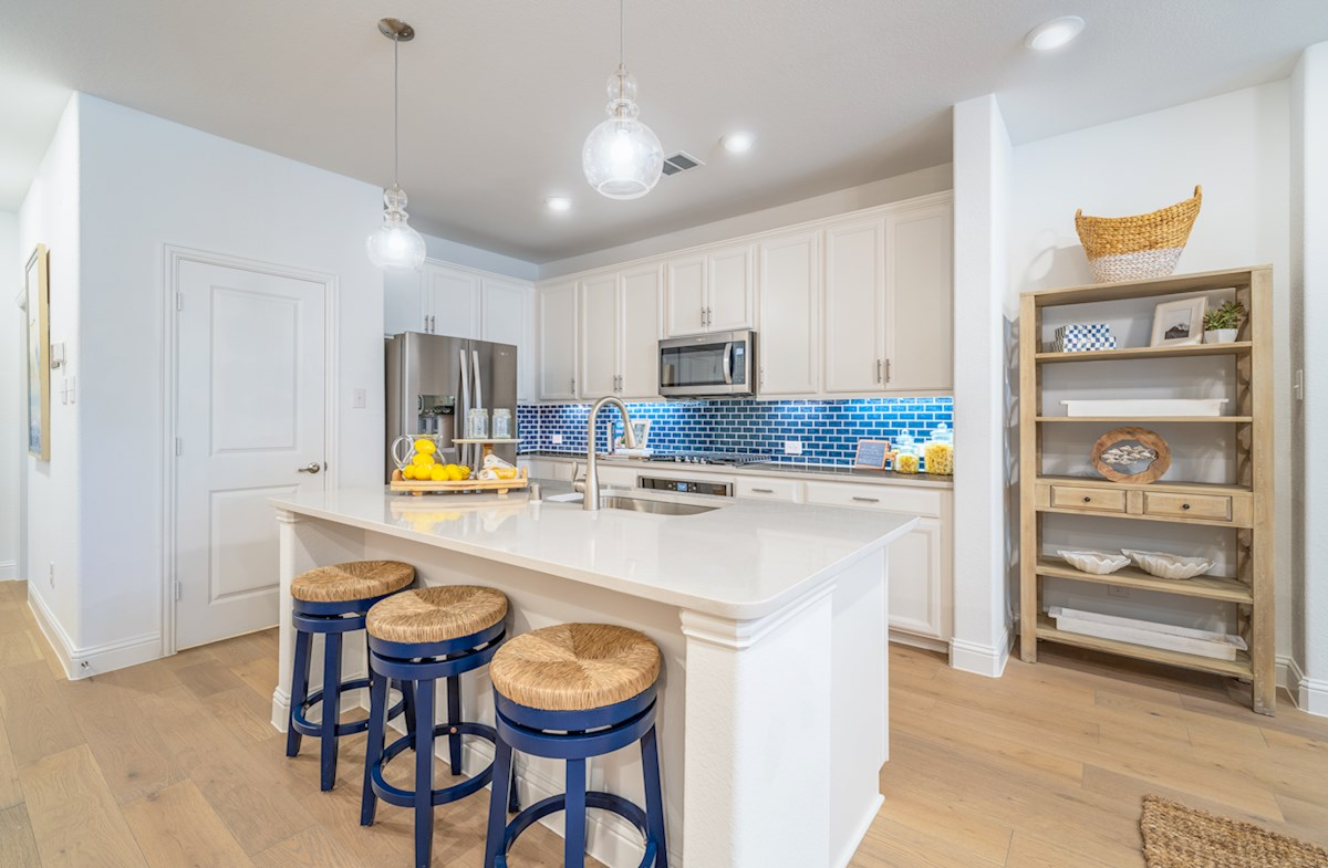 townhome kitchen with white cabinets