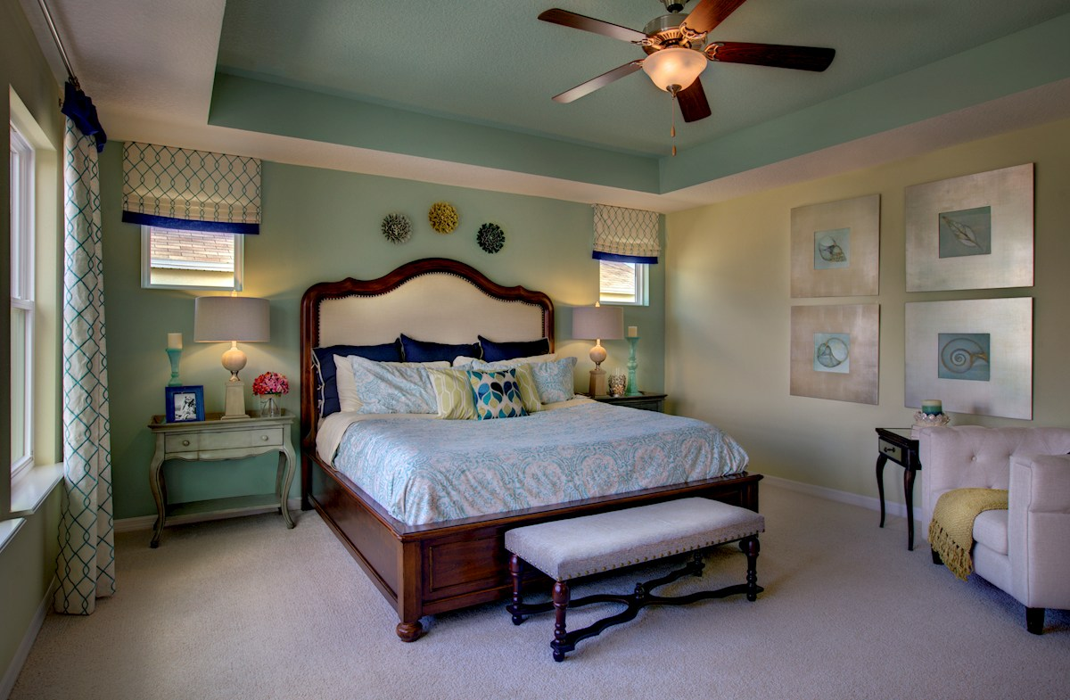 The Reserve at Pradera Anna Maria Master bedroom with a tray ceiling
