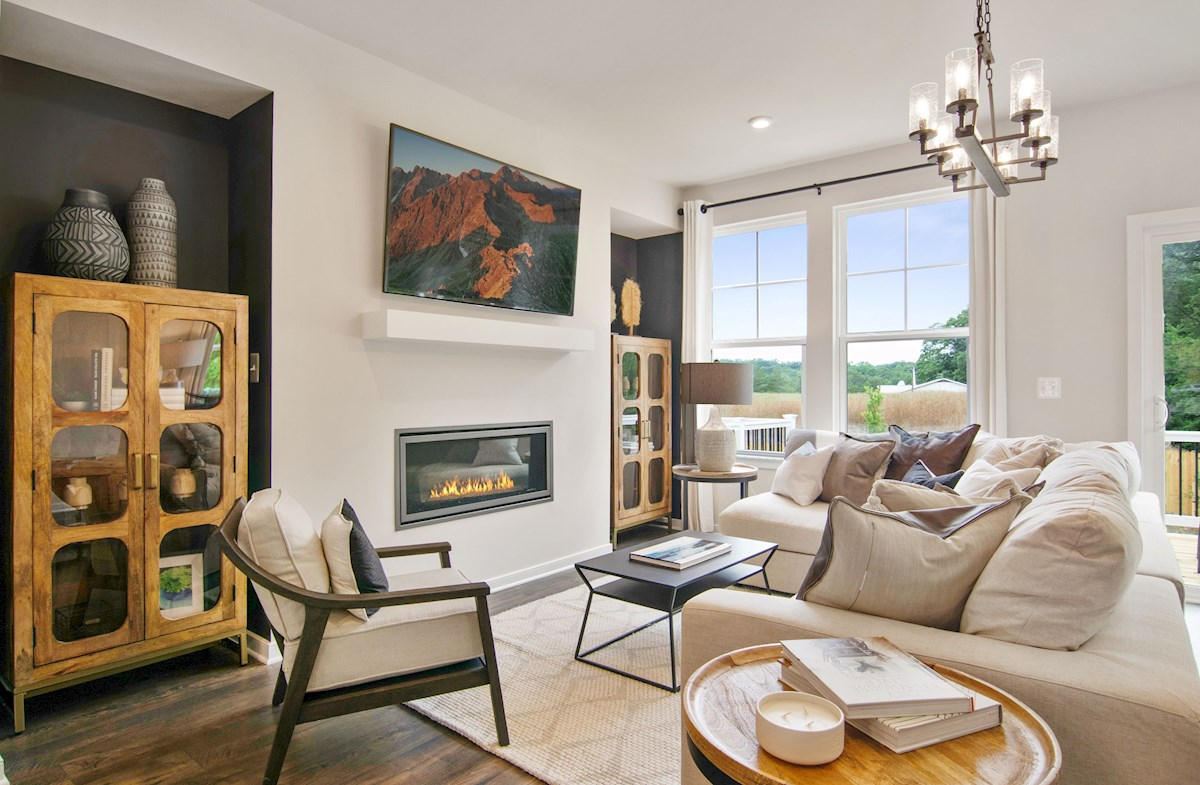 great room with two windows & gas fireplace