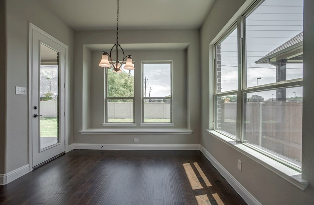 Summerfield quick move-in breakfast nook with wood floors and large windows