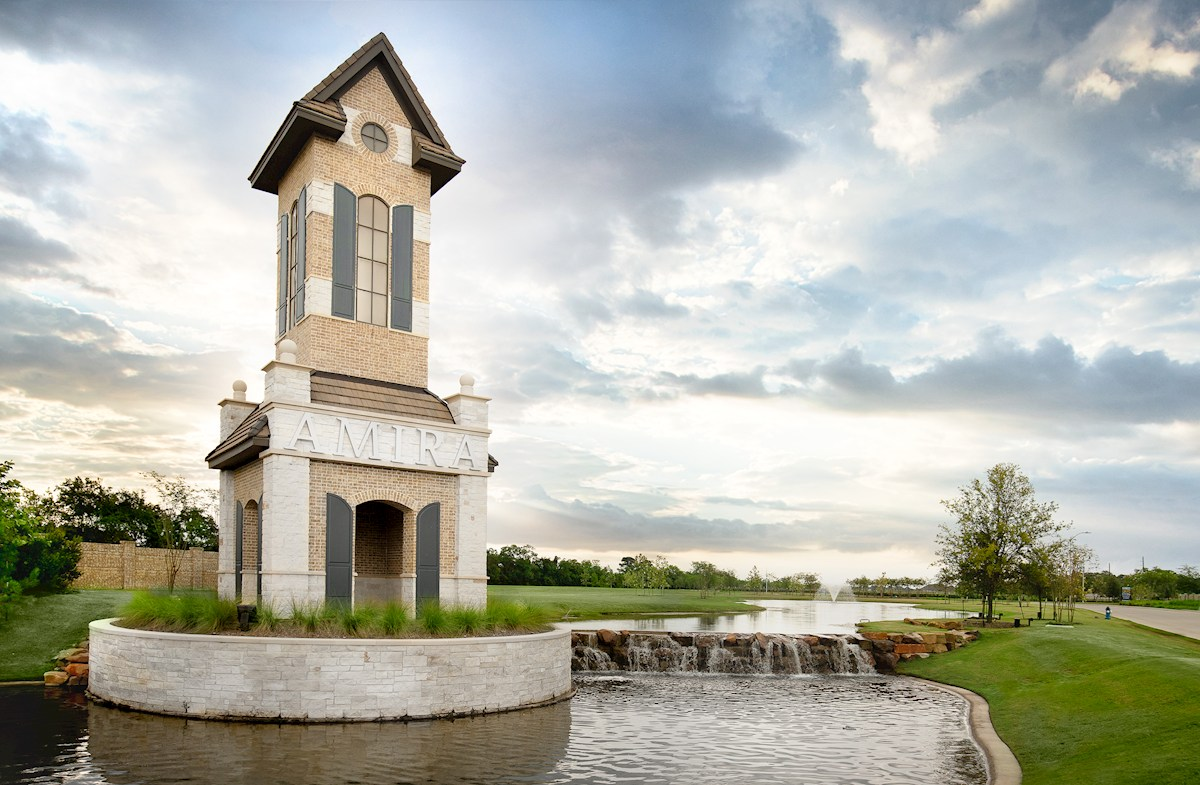 inviting entry with lakes and monument