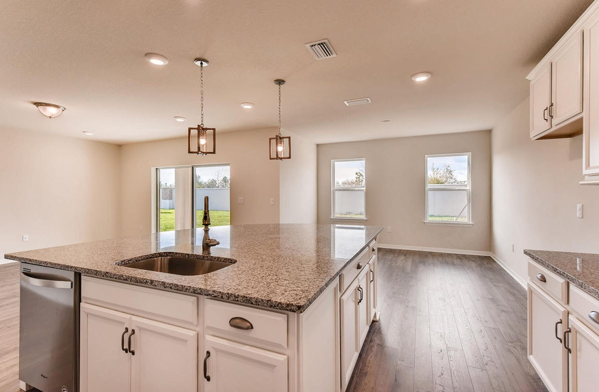 Cypress Pointe quick move-in Kitchen opens to dining and great room