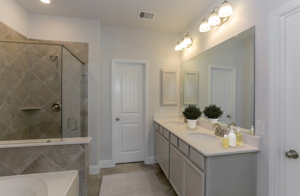 Bridgeland: Harmony Grove Spicewood master bathroom with separate tub and shower