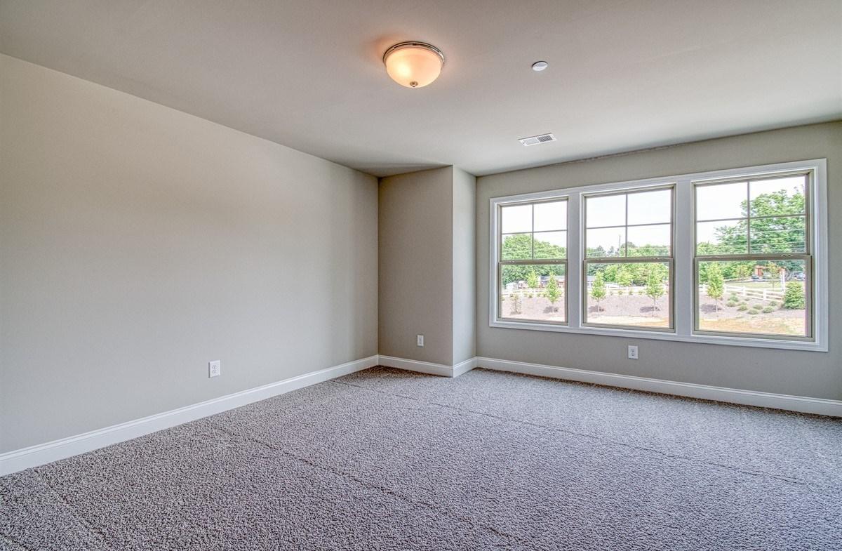 Lexington quick move-in Secondary Bedroom with three windows