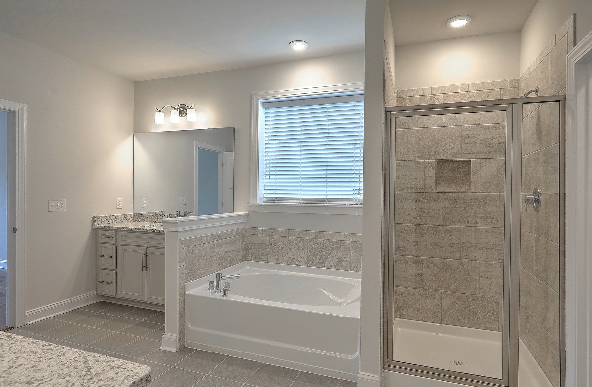 Sycamore quick move-in relaxing master bathroom