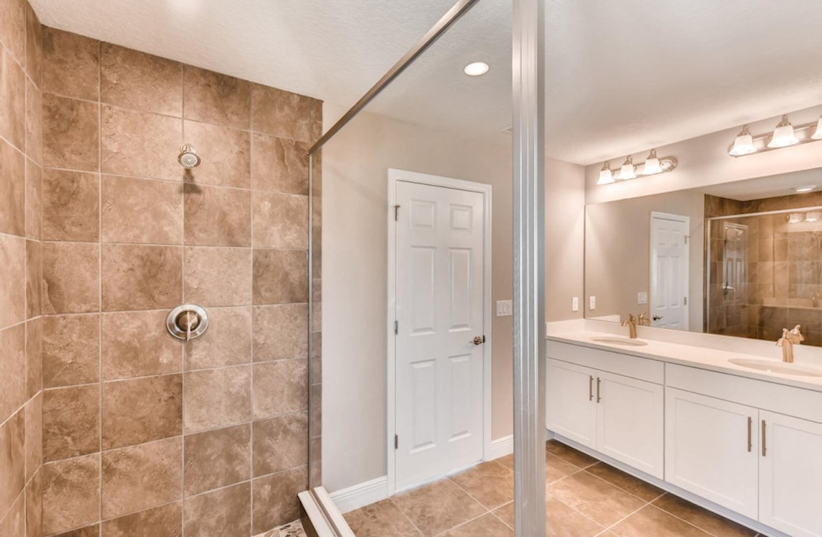 Lucia Bay quick move-in Master bathroom with glass enclosed walk-in shower