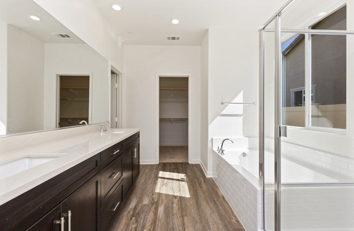 Napa quick move-in Located in the owner's suite, the deluxe master bath features separate vanities, a spacious walk-in closet, and a spa-inspired soaking tub