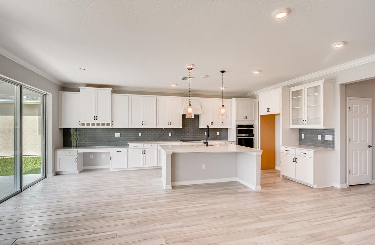 Sequoia quick move-in Open kitchen with an island