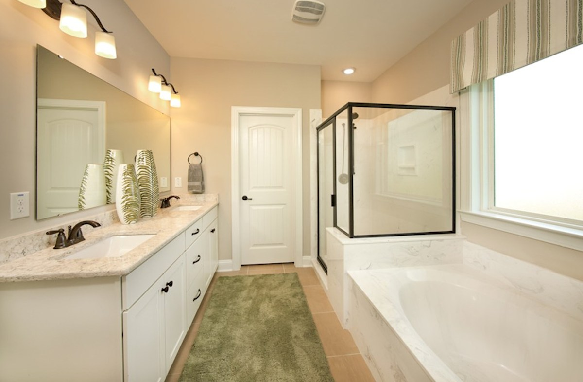 Belle Mer Reynolds master bathroom with dual shower and garden bathtub