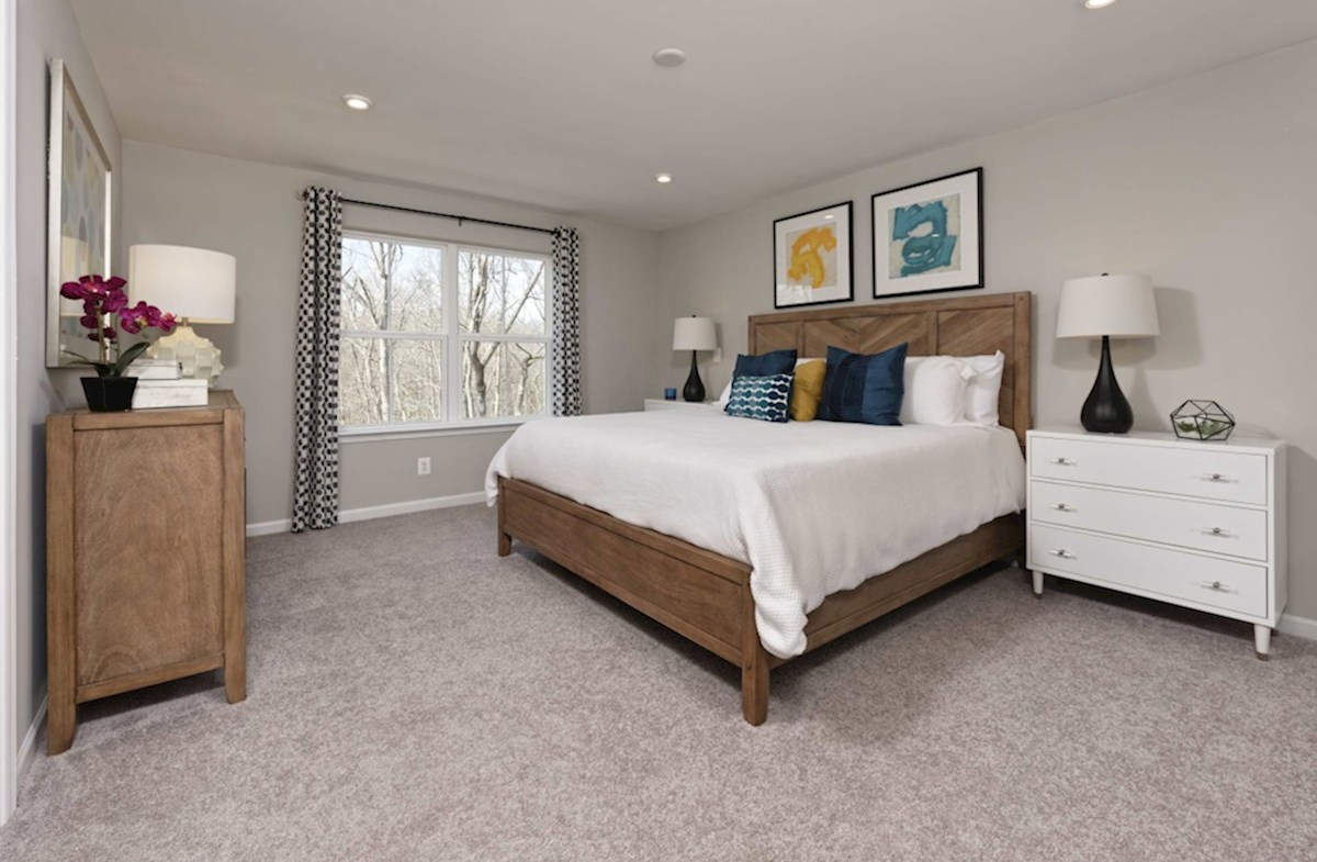 Riverwalk at Crofton Potomac Potomac master suite with carpet and large windows