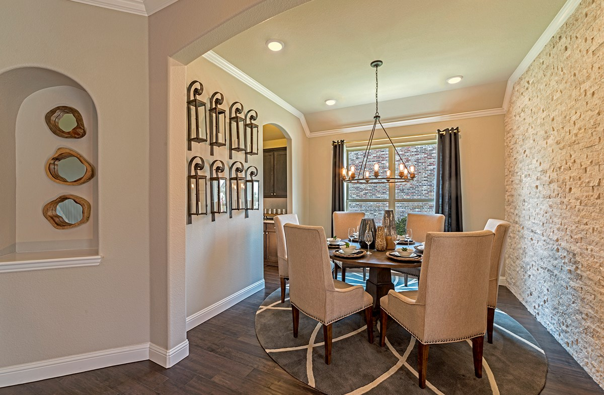 Miramonte Kerrville formal dining room with wood flooring