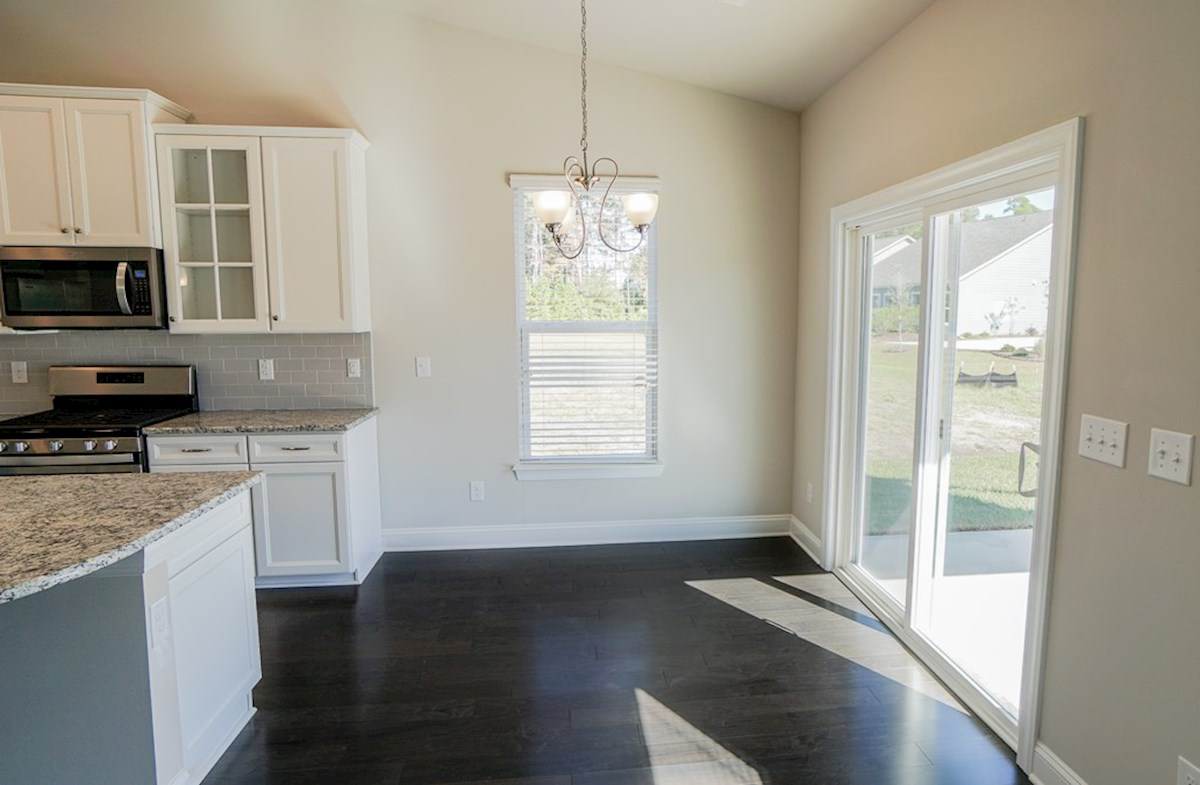 Savannah quick move-in casual dining with easy access to the covered porch