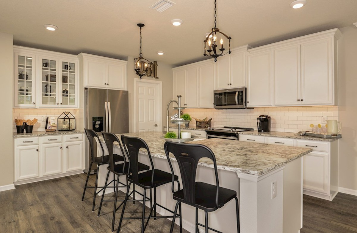 Avalon Park West Cypress Pointe Kitchen with white cabinets and center island