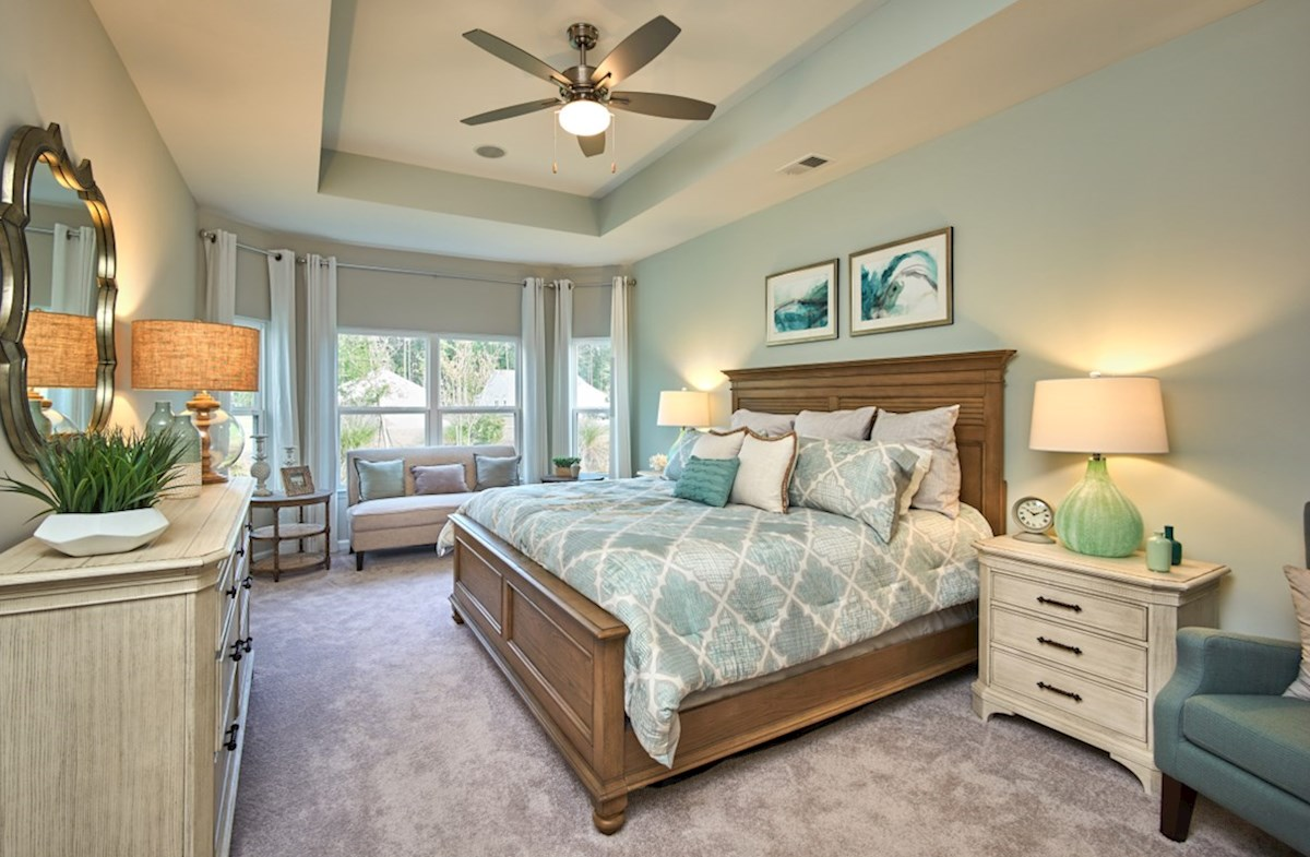 Surfside Plantation Savannah master bedroom features bay windows