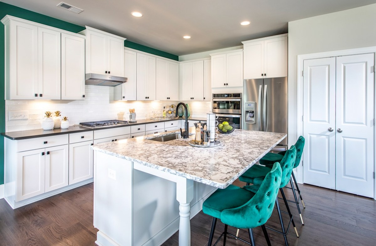 Macland Preserve Laurelwood Kitchen with white cabinets