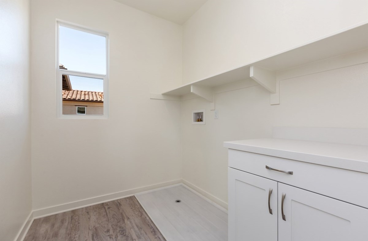Suncup quick move-in Oversized laundry room so you can fit an ironing board and optional cabinets or countertops
