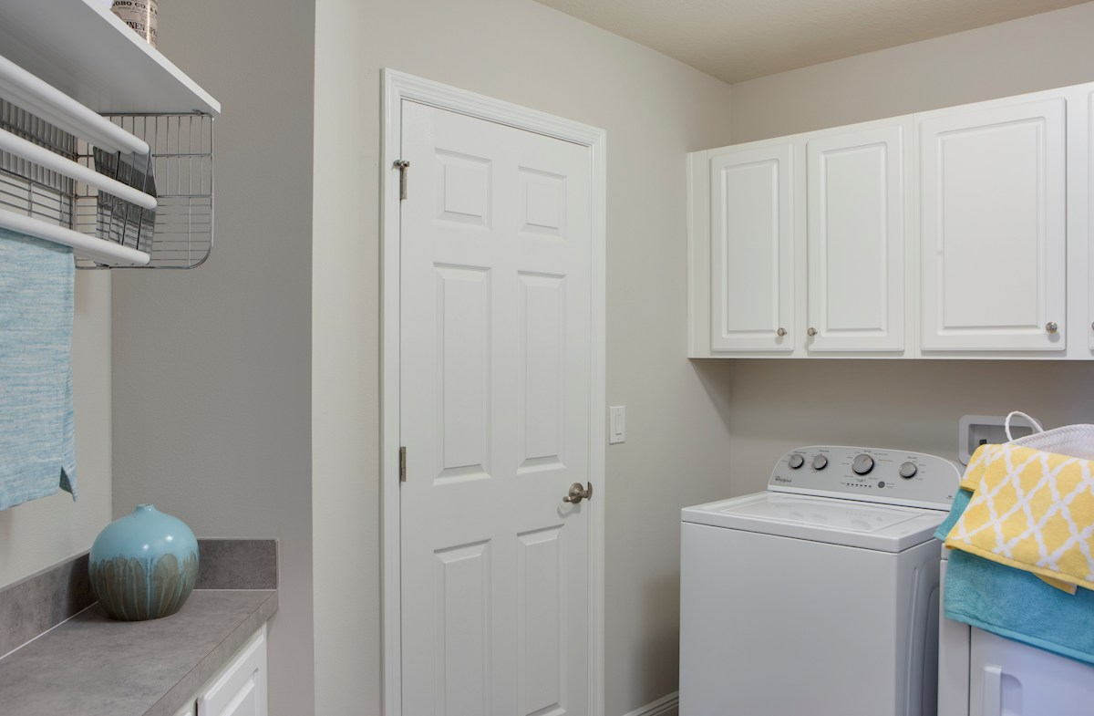 Long Lake Ranch Townhomes Erie Upstairs washer dryer in laundry room
