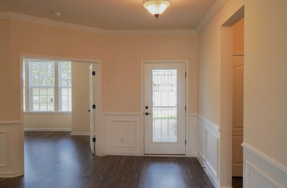 Valleydale quick move-in foyer features hardwoods and elegant trim