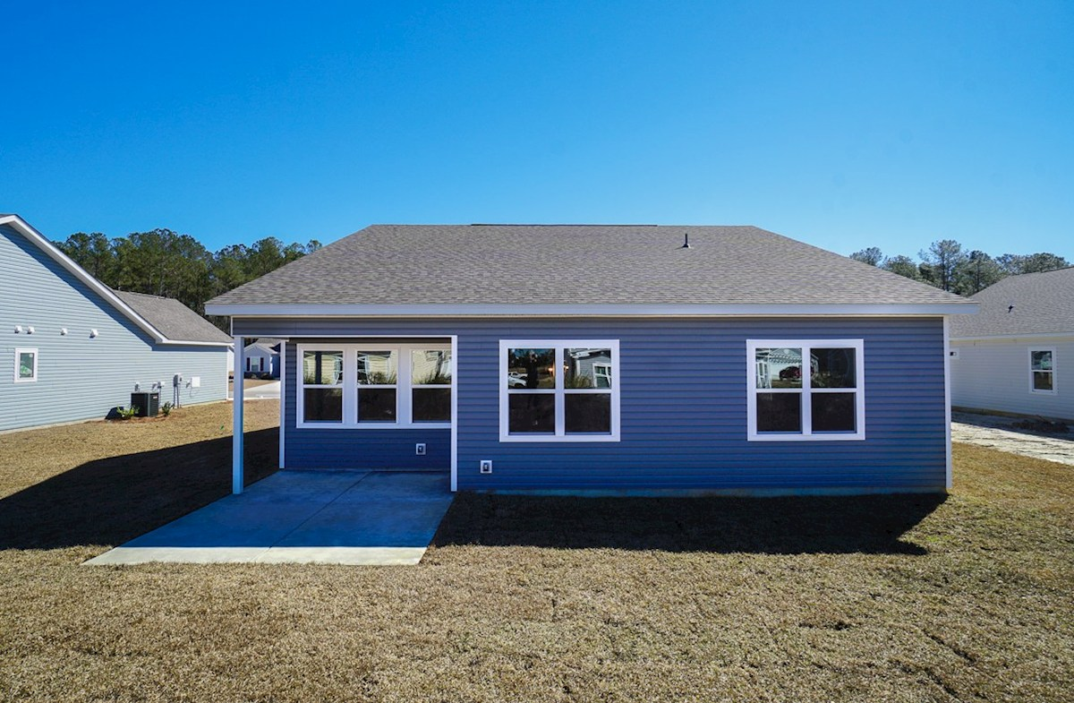 Summerton quick move-in backyard features covered porch with additional patio
