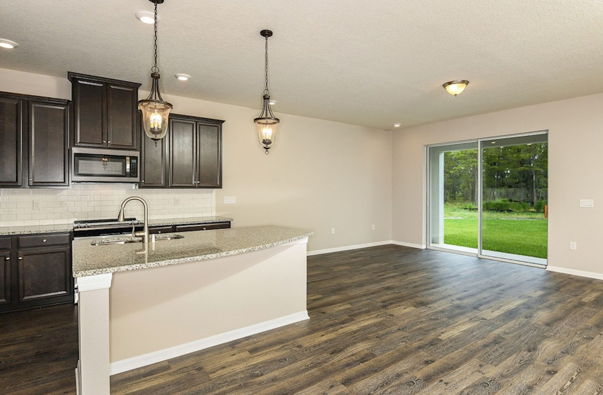 Siesta Key quick move-in Kitchen and great room with laminate flooring