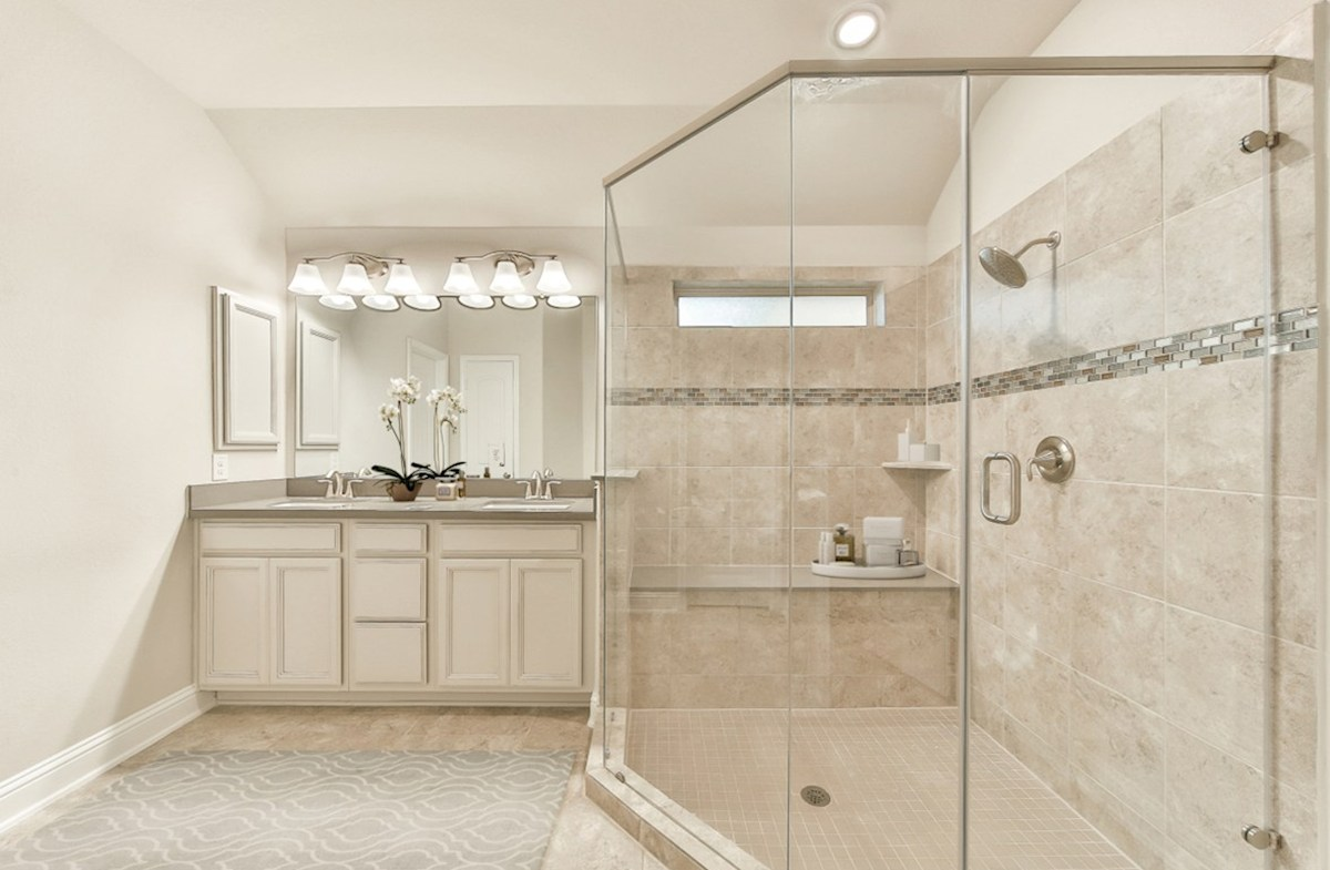 Young Ranch Anderson master bath with tile flooring and oversized shower