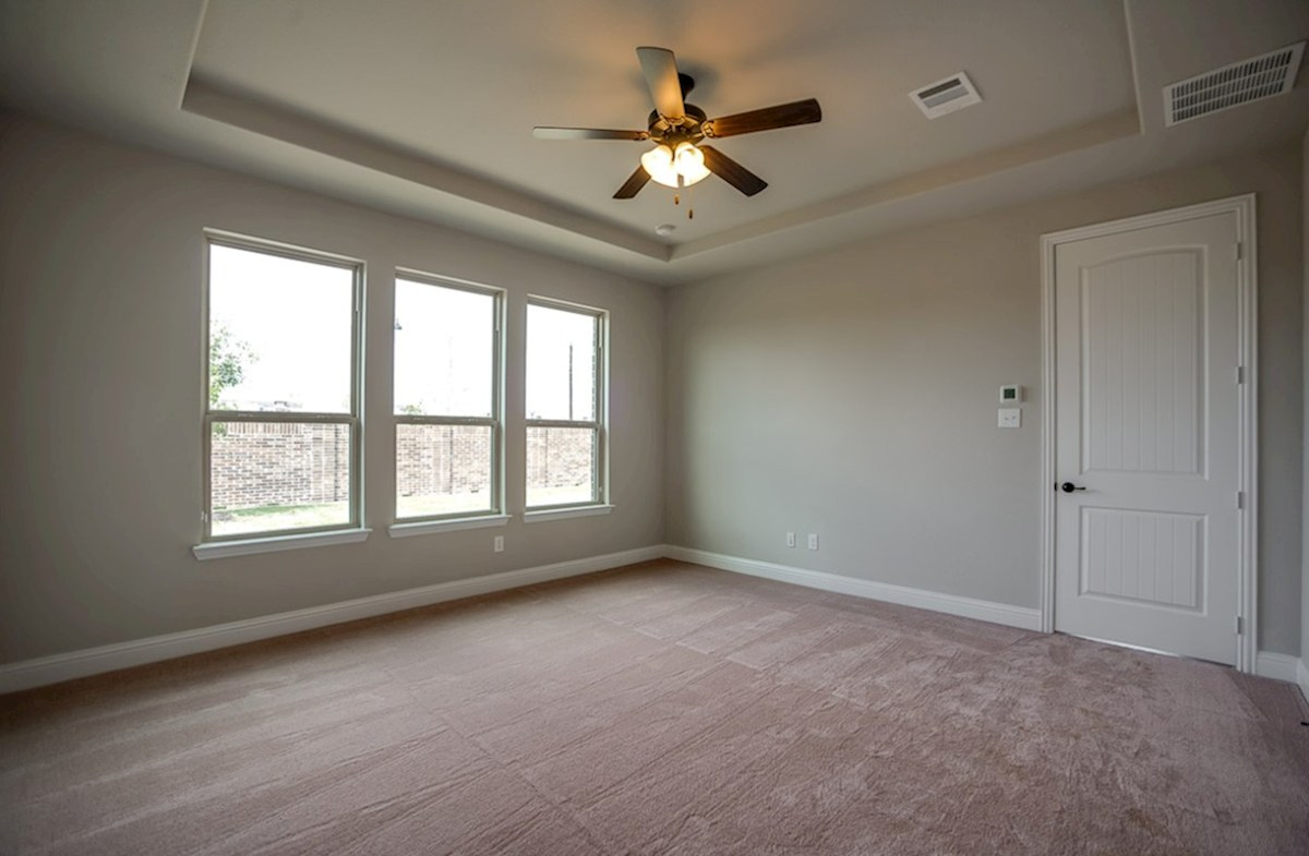 Summerfield quick move-in master bedroom with tray ceiling