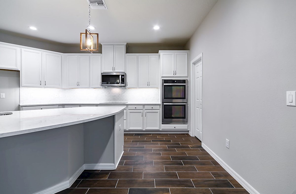 Redwood quick move-in Gourmet kicthen featuring double wall oven