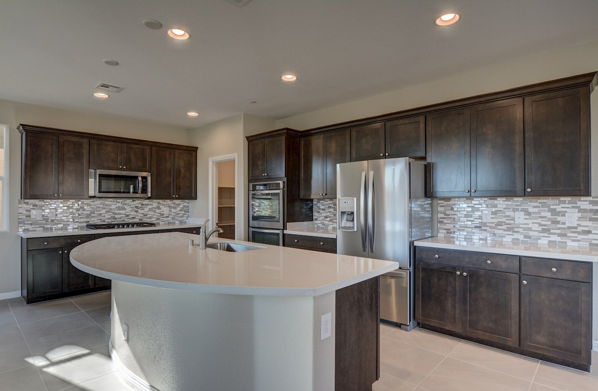 Choice Kitchen A features large granite island