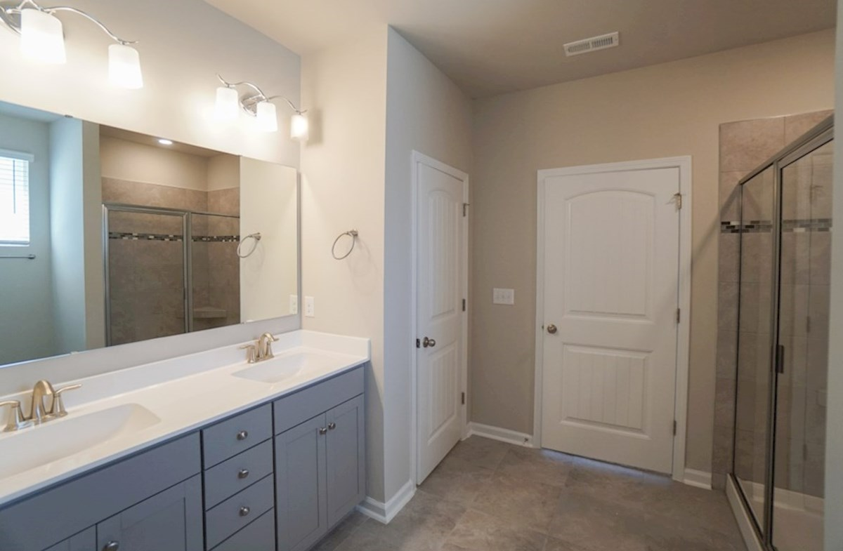 Georgetown quick move-in master bathroom features a walk-in shower