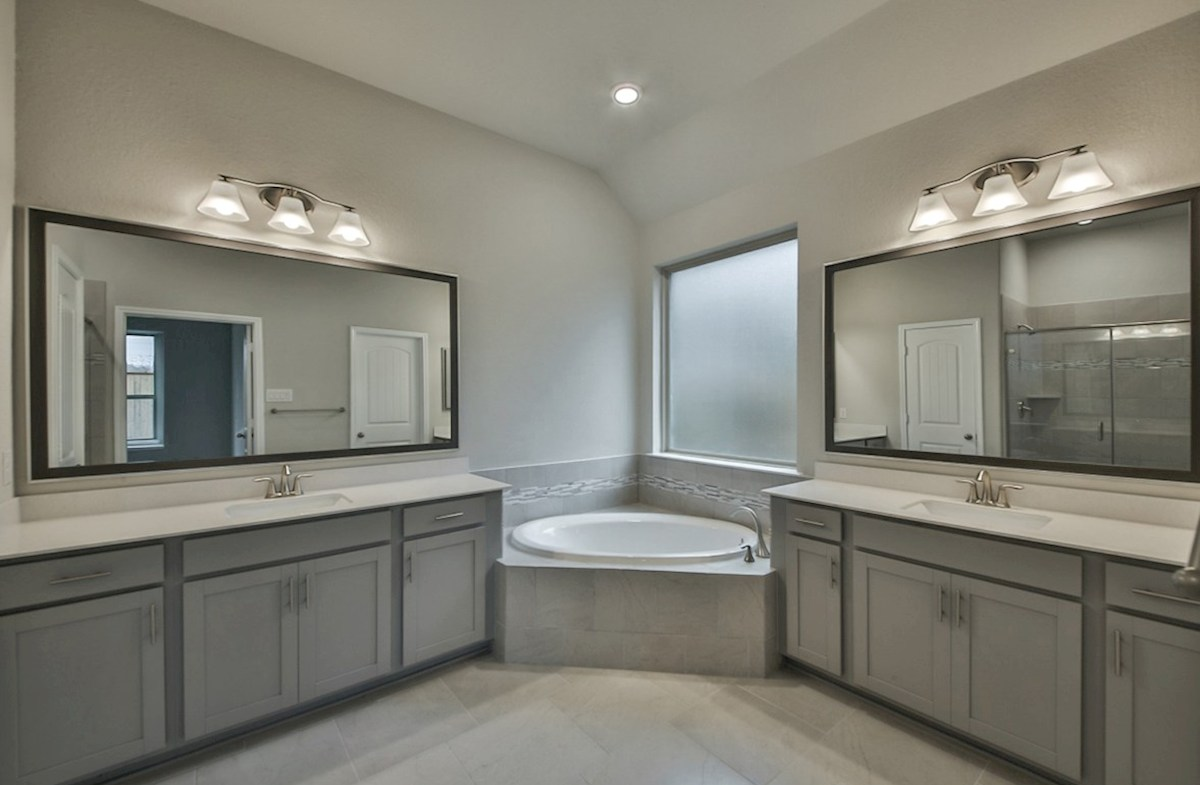 Caldwell quick move-in master bath with tile flooring, garden tub and separate shower