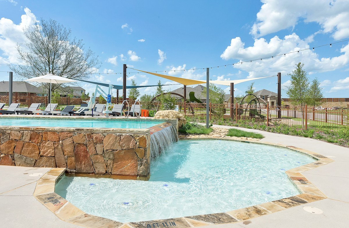 community pool and splash pad with stone
