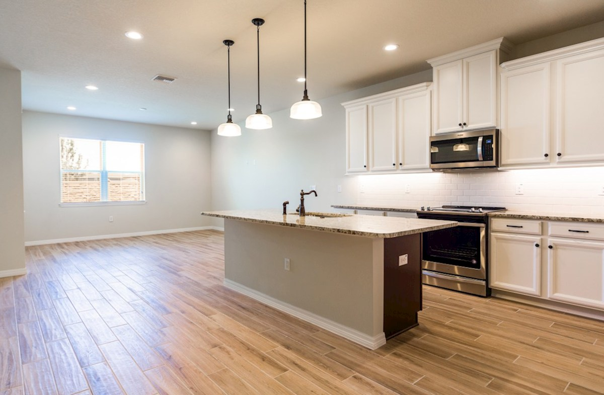 Champlain quick move-in Kitchen and great room with wood-look tile