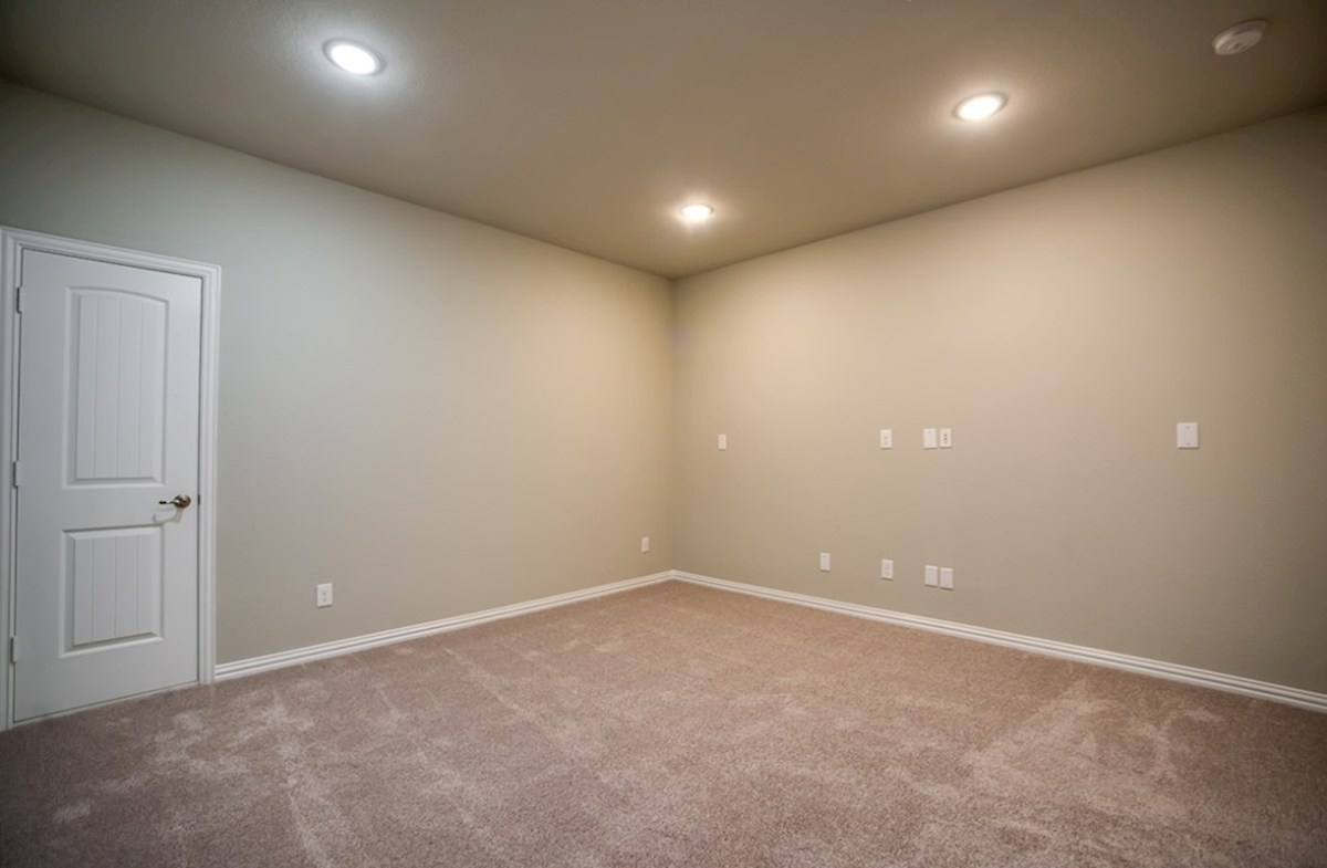 Trinity quick move-in large media room with recessed lighting and carpet