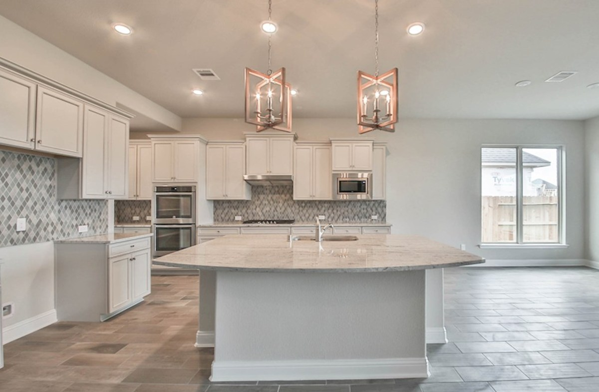 Northcliffe quick move-in kitchen with granite island, tile floors and stainless steel a appliances