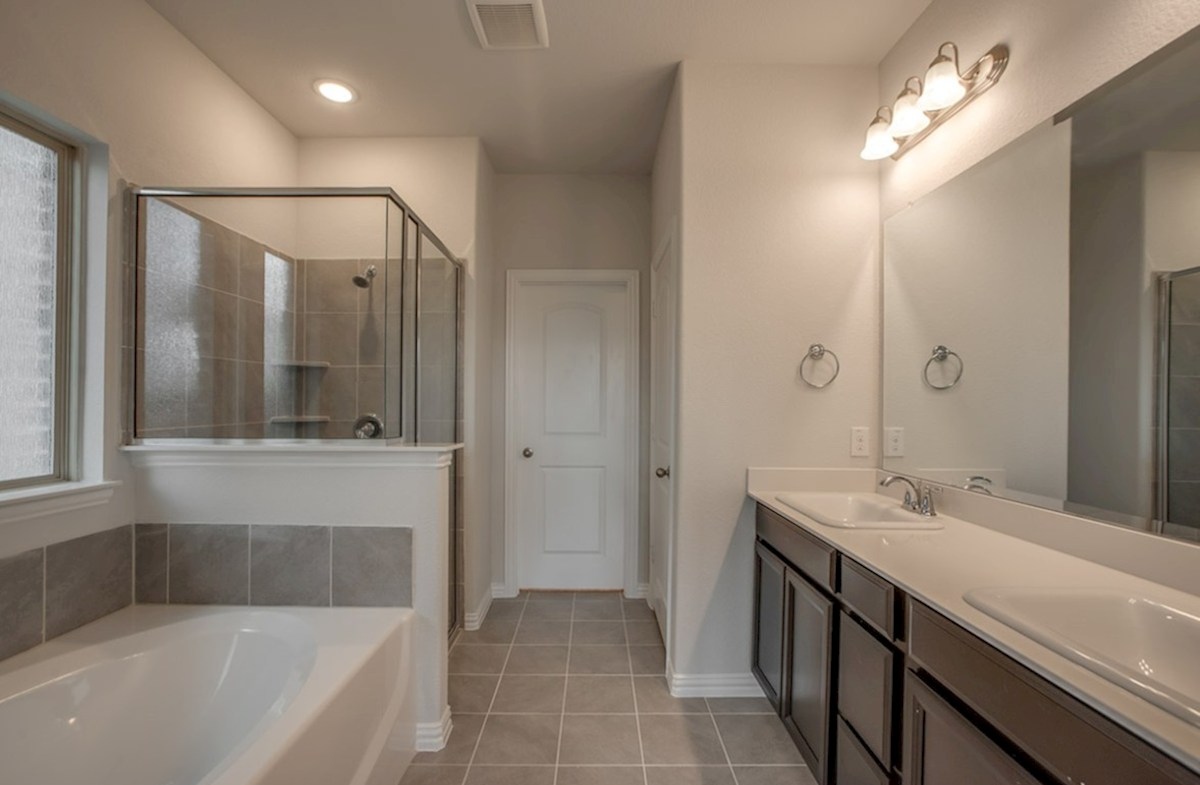 Avalon quick move-in master bathroom with large soaking tub and shower