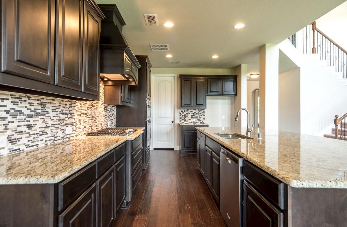 Gruene quick move-in kitchen with granite countertops with decorative backsplash
