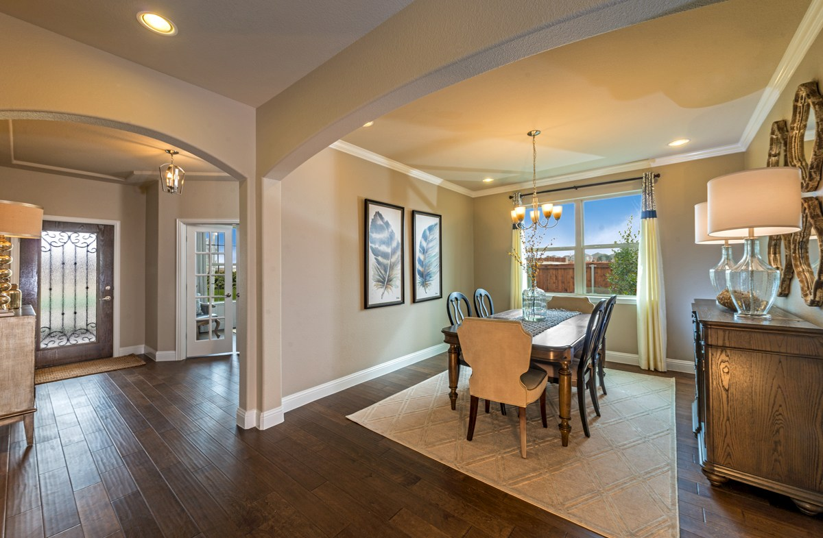 Avalon formal dining room boasts wood flooring