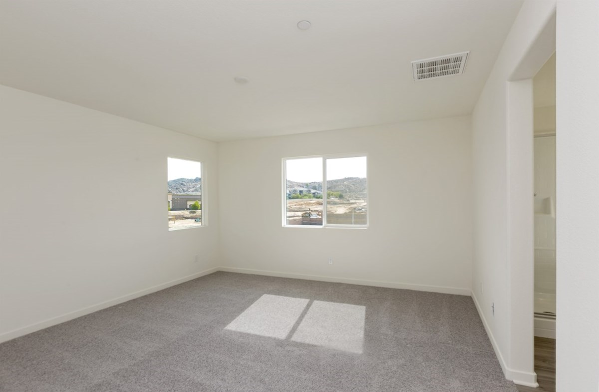 Paxton quick move-in Master bedroom located in the back of home for best exterior views and natural light