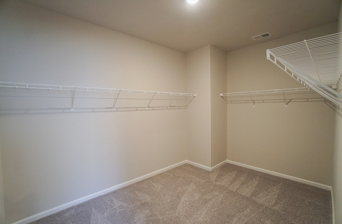 Southport quick move-in walk-in closet features plenty of storage space