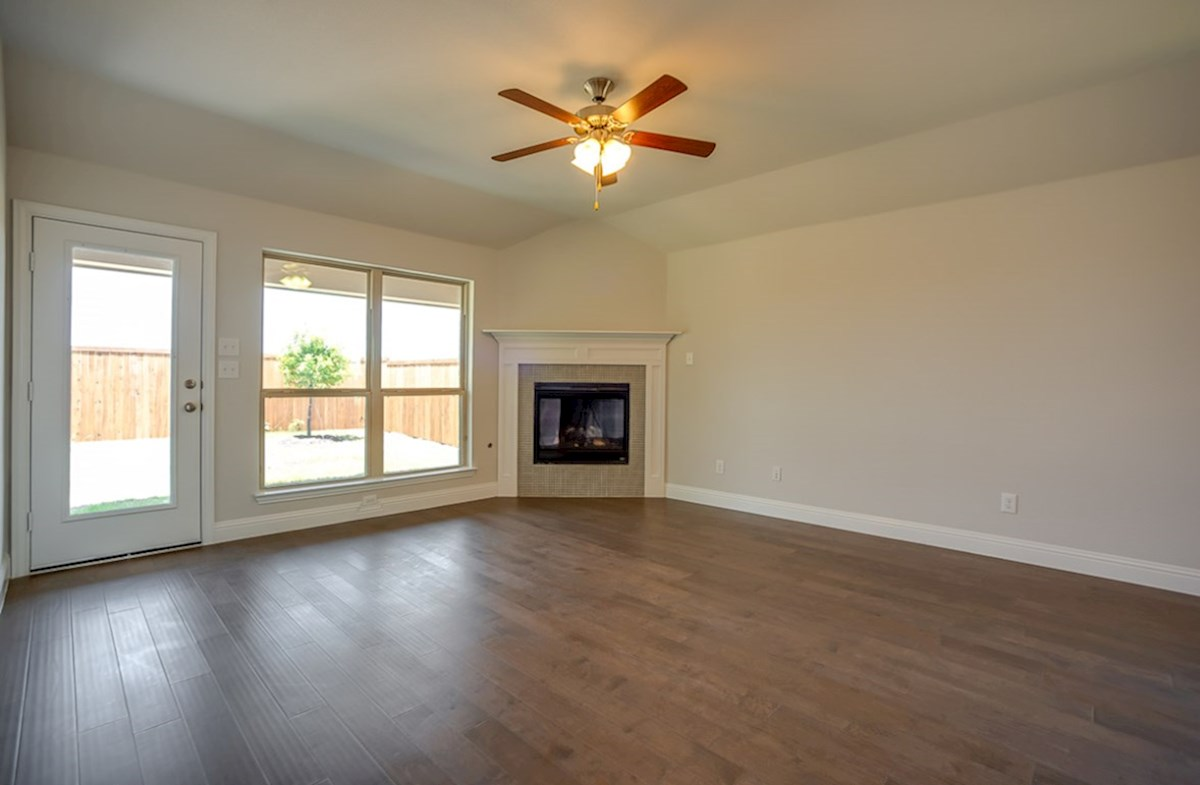Millbrook quick move-in great room with wood flooring and fireplace