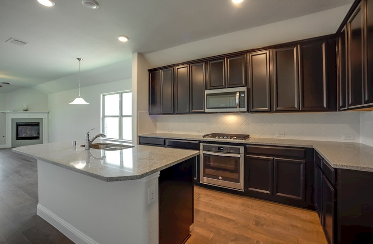 Millbrook quick move-in kitchen opens to breakfast area