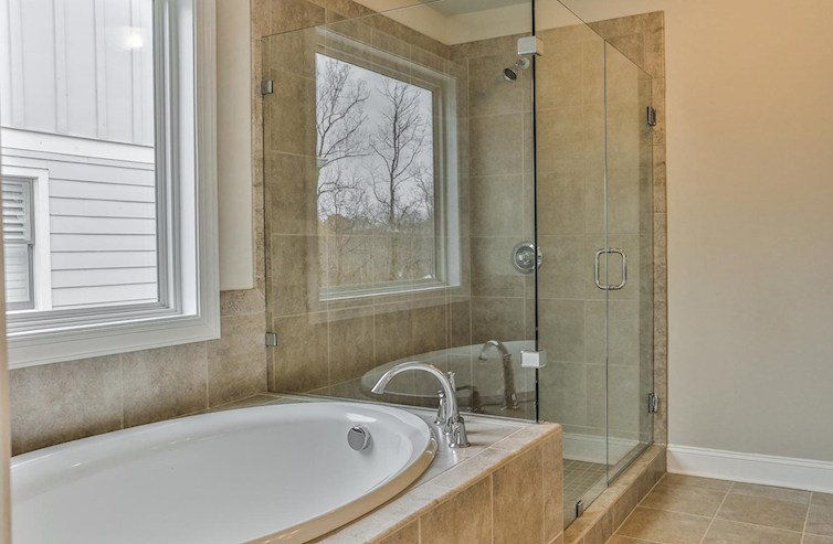Spacious bathrooms with soaker tubs