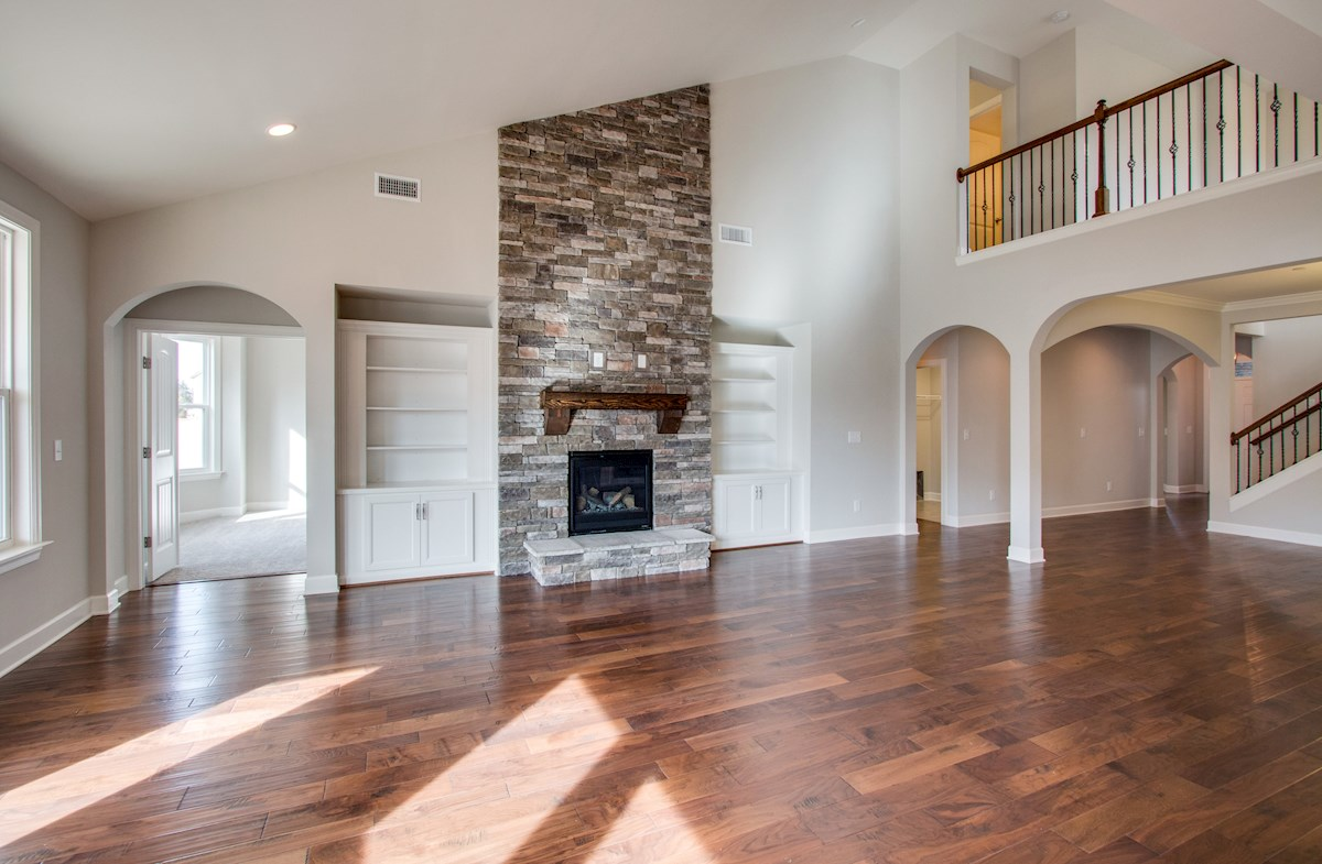 Greenwich quick move-in stone fireplace in two-story great room