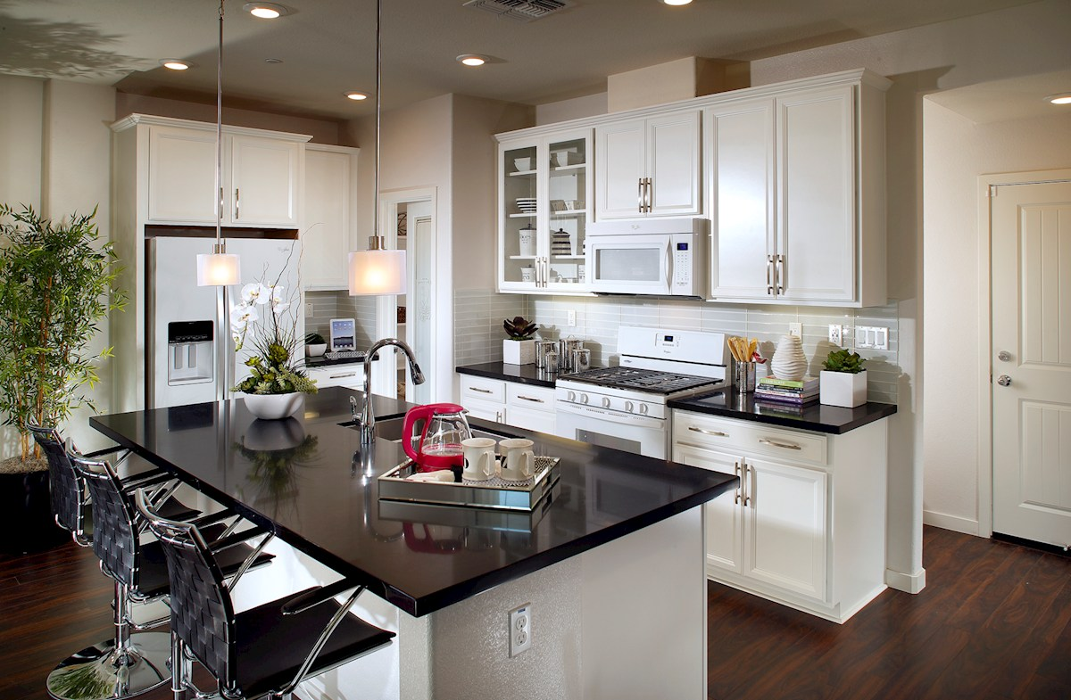 Natomas Field Augustus White kitchen cabinets with dark granite counters