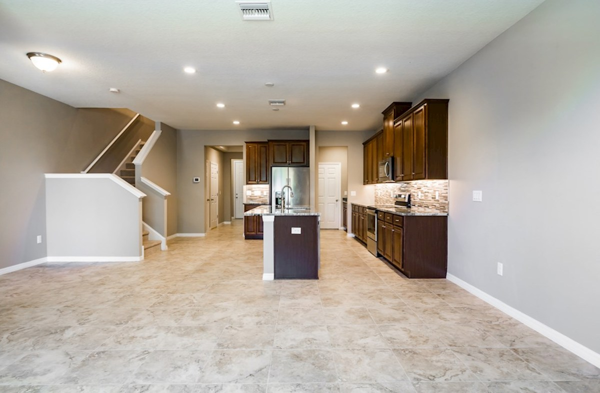 Champlain quick move-in Open kitchen and great room with tile flooring