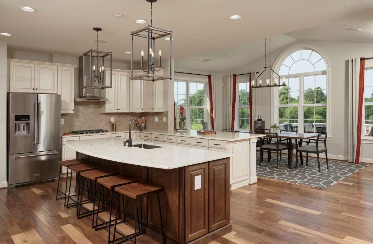 Brookview kitchen and sunroom with hardwood floors