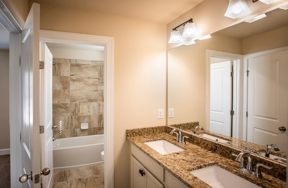 Cambridge quick move-in Secondary Bathroom with dual sinks