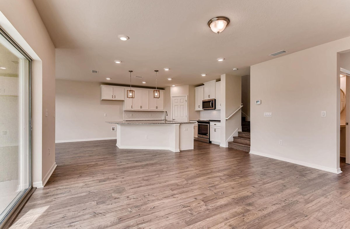 Cypress Pointe quick move-in Open kitchen and great room with laminate flooring
