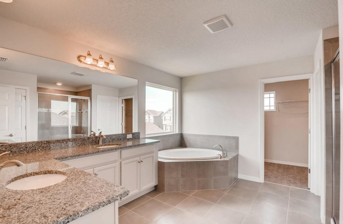 Captiva quick move-in Master bathroom with dual sinks garden tub and seperate glass shower