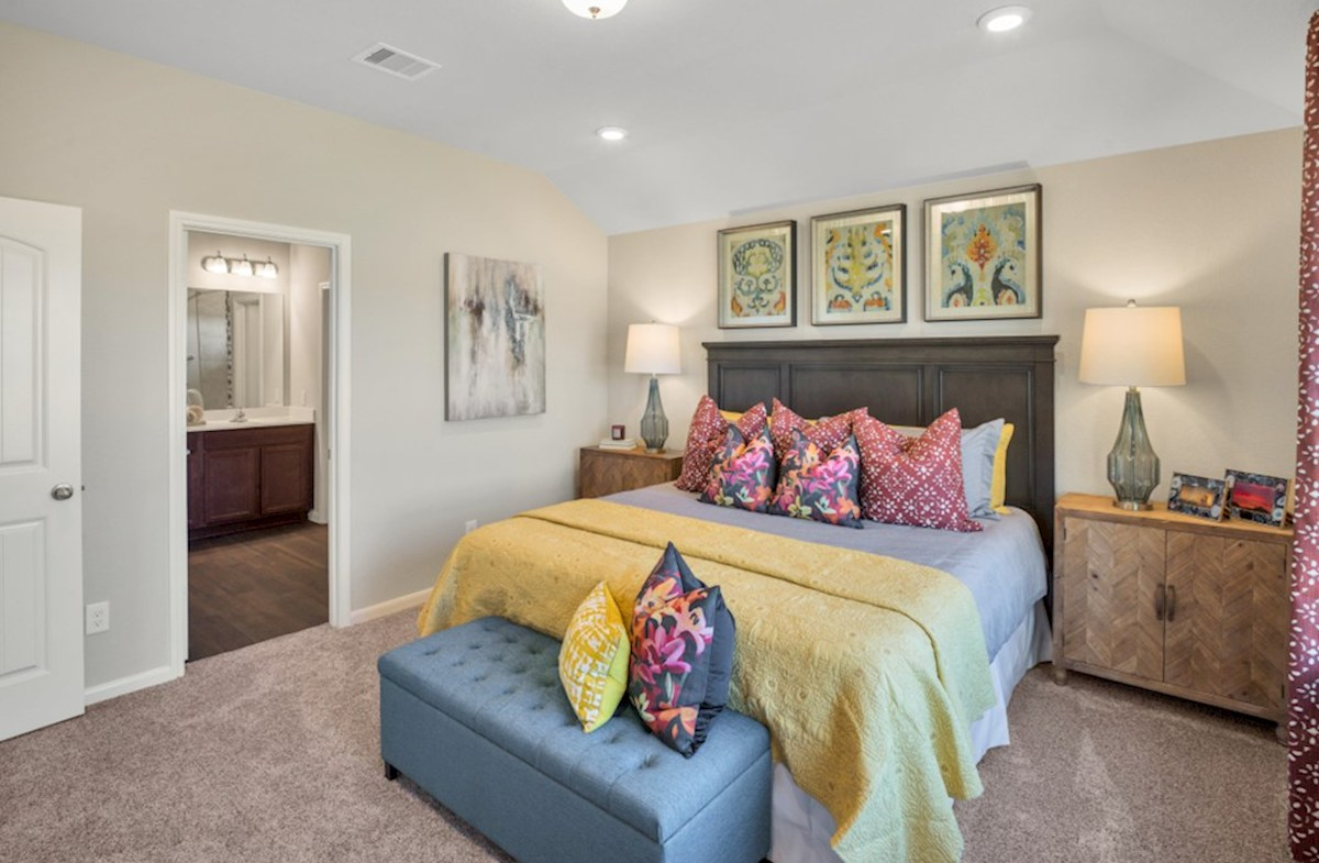 Lantana Austin master bedroom with plush carpet flooring